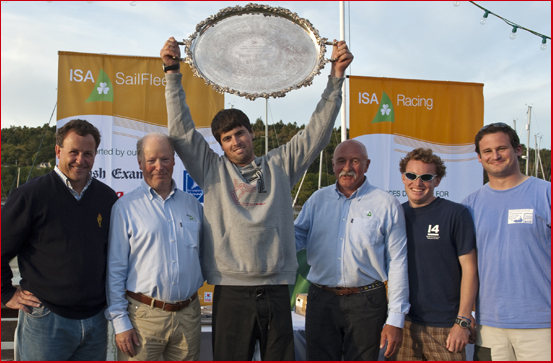 Nicholas O'Leary, winning champion for the second year in a  row of the All Ireland Sailing Championship, holds the trophy aloft.  Pic shows L. to R. Mike MacCarthy Admiral RCYC, Ed Alcock Racing Manager ISA, Nicholas O'Leary Winner,Peter Crowley, President ISA, Marty O'Leary and Adam McCarthy winning crew members.  Photo Robert Bateman